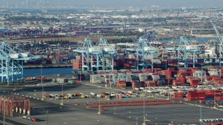 AX0161_014 - 8K stock footage aerial video of cranes and shipping containers at the Port of Los Angeles, California