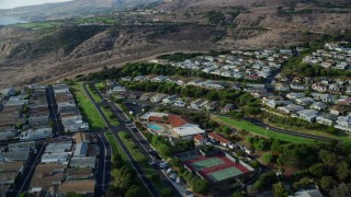 AX0161_020 - 8K stock footage aerial video passing hillside homes in San Pedro, California
