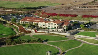 AX0161_022 - 8K stock footage aerial video of Trump National Golf Club clubhouse in Rancho Palos Verdes, California