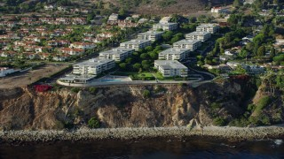 AX0161_025 - 8K stock footage aerial video of Palos Verdes Bay Club condo complex in Rancho Palos Verdes, California
