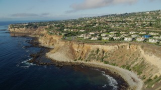 AX0161_028 - 8K stock footage aerial video flying over clifftop mansions in Rancho Palos Verdes, California