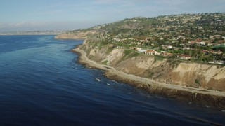 AX0161_031 - 8K stock footage aerial video of mansions on coastal cliffs in Palos Verdes Estates, California