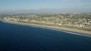 AX0161_034 - 8K stock footage aerial video approaching Torrance Beach in the seaside city of Redondo Beach, California