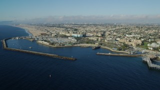 AX0161_036 - 8K stock footage aerial video flying by Redondo Beach, California and approach King Harbor Marina