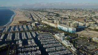 AX0161_037 - 8K stock footage aerial video flying over marina and power plant in Redondo Beach, California to approach Hermosa Beach Pier