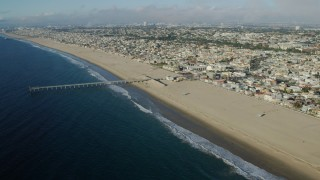 AX0161_038 - 8K stock footage aerial video of the seaside city of Hermosa Beach, California seen from Hermosa Beach Pier
