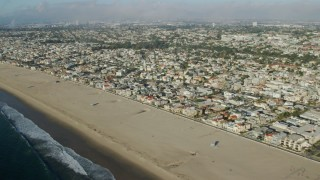 AX0161_039 - 8K stock footage aerial video flying over the beach and coastal neighborhoods in Hermosa Beach, California