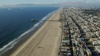 AX0161_040 - 8K stock footage aerial video of Manhattan Beach Pier seen while flying over beachside neighborhoods in Manhattan Beach, California