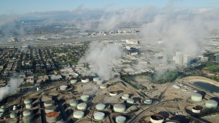 AX0161_043 - 8K stock footage aerial video of low level clouds over the Chevron Refinery in El Segundo, California
