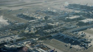 AX0161_048 - 8K stock footage aerial video of a reverse view of the control tower and terminals at LAX, California