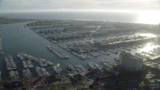 AX0161_056 - 8K stock footage aerial video of boats at the marinas and waterfront apartment buildings in Marina Del Rey, California