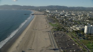 AX0161_067 - 8K stock footage aerial video flying over beach to approach the Santa Monica Pier, California