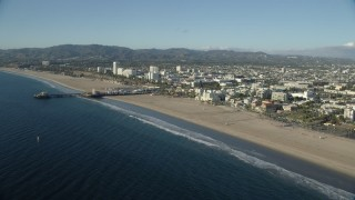 AX0161_068 - 8K stock footage aerial video approaching the Santa Monica Pier and beach, California