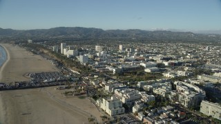 AX0161_069 - 8K stock footage aerial video flying over the beach to approach shops and Santa Monica Place mall in Santa Monica, California