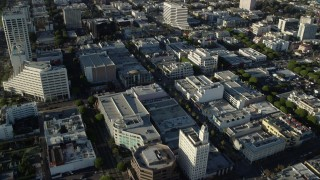 AX0161_070 - 8K stock footage aerial video following 2nd Street past shops and office buildings in Santa Monica, California