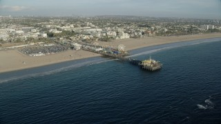AX0161_078 - 8K stock footage aerial video flying by the end of Santa Monica Pier in Santa Monica, California