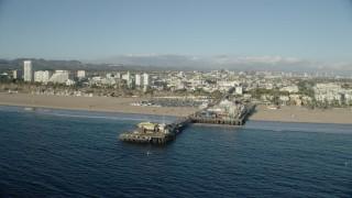 AX0161_079 - 8K stock footage aerial video of Santa Monica Pier and beach seen from the ocean, Santa Monica, California