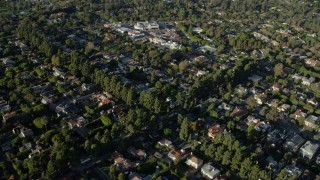 AX0161_085 - 8K stock footage aerial video flying over upscale neighborhoods toward a small shopping center in Brentwood, California