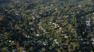 AX0161_087 - 8K stock footage aerial video passing upscale, tree-lined neighborhoods in Brentwood, California