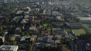 AX0161_090 - 8K stock footage aerial video of an orbit of campus buildings at College in Los Angeles, California