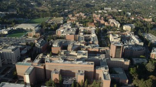 AX0161_093 - 8K stock footage aerial video orbiting College university campus buildings in Los Angeles, California