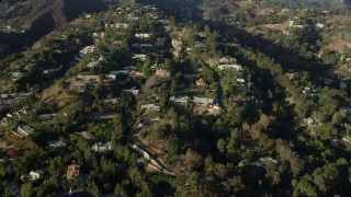 AX0161_099 - 8K stock footage aerial video of spacious hillside mansions in Beverly Hills, California