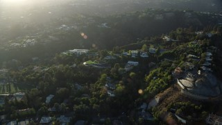AX0161_102 - 8K stock footage aerial video of a reverse view of hillside mansions in Beverly Glen, Los Angeles, California