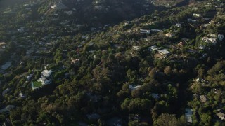 AX0161_103 - 8K stock footage aerial video flying away from hillside mansions in Beverly Hills, California