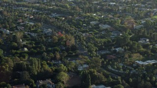 AX0161_105 - 8K stock footage aerial video flying by mansions in upscale neighborhoods in Beverly Hills, California