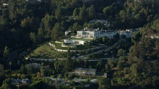 AX0161_107 - 8K stock footage aerial video flying by a large hillside mansion in Beverly Hills, California