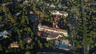 AX0161_110 - 8K stock footage aerial video of a reverse view of the Beverly Hills Hotel in Beverly Hills, California