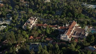 AX0161_111 - 8K stock footage aerial video orbiting the Beverly Hills Hotel in Beverly Hills, California