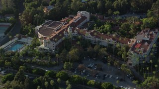 AX0161_113 - 8K stock footage aerial video orbiting the Beverly Hills Hotel in Beverly Hills, California
