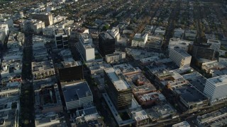 AX0161_114 - 8K stock footage aerial video flying over office buildings on Camden Drive in Beverly Hills, California