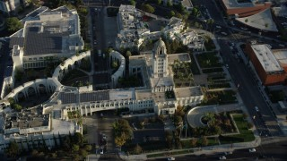 AX0161_118 - 8K stock footage aerial video flying by and away from city hall in Beverly Hills, California