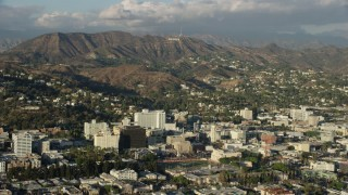 AX0161_120 - 8K stock footage aerial video of the Hollywood Sign, and office buildings in Hollywood, California