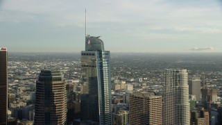 AX0162_013 - 8K stock footage aerial video flying by the Wilshire Grand Center skyscraper in Downtown Los Angeles, California