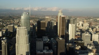 AX0162_019 - 8K stock footage aerial video flying between Wilshire Grand Center and Aon Center to approach US Bank Tower, Downtown Los Angeles, California