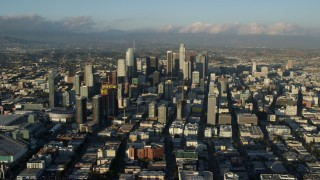 AX0162_037 - 8K stock footage aerial video of the LA Convention Center and skyscrapers in Downtown Los Angeles, California