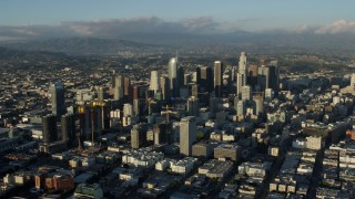 AX0162_038 - 8K stock footage aerial video of skyscrapers in Downtown Los Angeles, California surrounded by city sprawl