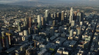 AX0162_039 - 8K stock footage aerial video approaching the skyscrapers in Downtown Los Angeles, California from southwest of the city