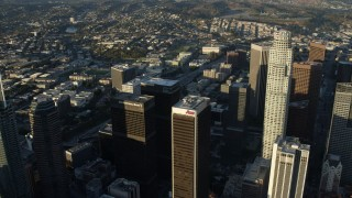 AX0162_041 - 8K stock footage aerial video flying over Aon Center and approach heavy 110 traffic in Downtown Los Angeles, California