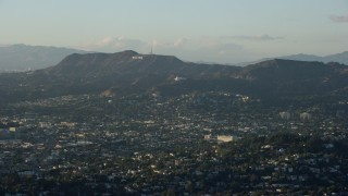 AX0162_043 - 8K stock footage aerial video of the Hollywood Sign and Griffith Observatory seen from Silver Lake, California