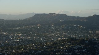 AX0162_044 - 8K stock footage aerial video of the Hollywood Sign and Griffith Observatory seen from Silver Lake, California