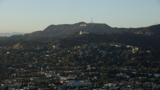 AX0162_047 - 8K stock footage aerial video of the Hollywood Sign, Griffith Observatory, and Los Feliz homes in Los Angeles, California