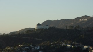 AX0162_052 - 8K stock footage aerial video orbiting Griffith Observatory to reveal the Hollywood Sign in Los Angeles, California