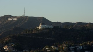 AX0162_053 - 8K stock footage aerial video orbiting Griffith Observatory with the Hollywood Sign in the background, Los Angeles, California