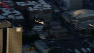 AX0162_055 - 8K stock footage aerial video tracking an LAPD helicopter flying over Hollywood, California