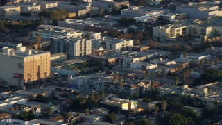 AX0162_057 - 8K stock footage aerial video of an LAPD helicopter flying over Hollywood, California
