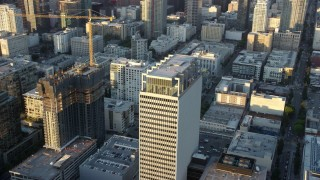 AX0162_068 - 8K stock footage aerial video orbiting Transamerica Center at twilight in Downtown Los Angeles, California